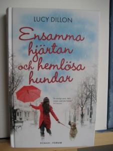 """Framsida på boken """"Ensamma hjärtan och hemlösa hundar"""""""